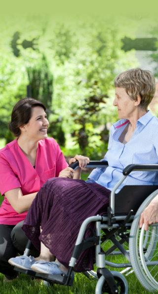 nurse and elderly woman in wheel chair