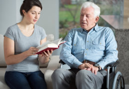 caretaker reading story to her patient